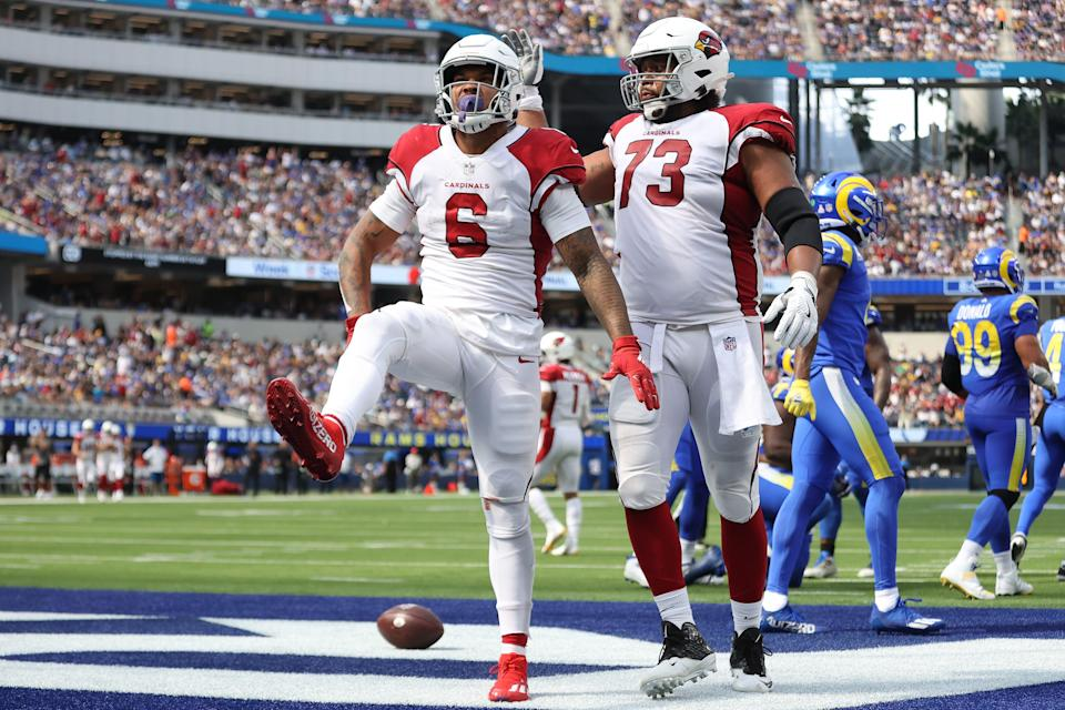 James Conner #6 of the Arizona Cardinals celebrates his touchdown with Max Garcia #73 in the second quarter against the Los Angeles Rams at SoFi Stadium on October 03, 2021 in Inglewood, California.