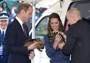 <p>Prince William and Kate Middleton hold puppies during a visit to the Royal New Zealand Police College.</p>