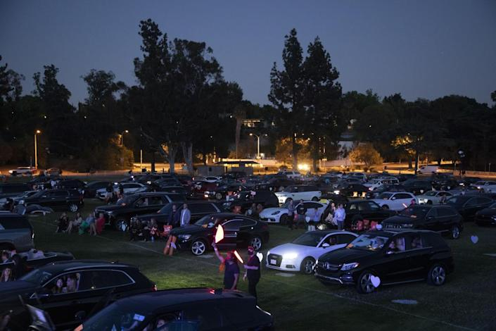 Rows of cars and their occupants at the Race to Erase MS drive-in concert at the Rose Bowl.
