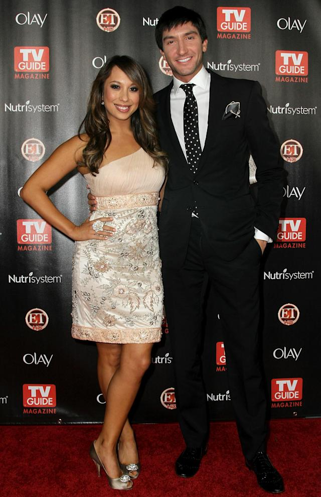 "HOLLYWOOD - NOVEMBER 08: TV Celebrity Cheryl Burke (L) and Evan Lysacek (R) arrive at TV Guide Magazine's ""2010 Hot List"" Party on November 8, 2010 in Hollywood, California. (Photo by Valerie Macon/Getty Images)"