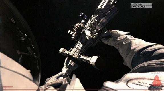 An astronaut works in the blackness of space in this still from the 2013 science fiction film 'Europa Report.'