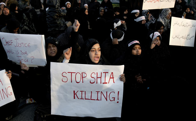 Pakistani Shiite Muslim women participate in a rally to condemn Thursday's deadly bombings in Quetta, in Islamabad, Pakistan, Sunday, Jan. 13, 2013. Thousands of Pakistani Shiites protested in southwestern Pakistan for a third day blocking a main road with dozens of coffins of relative killed in explosions to demand better security from the government. (AP Photo/Anjum Naveed)