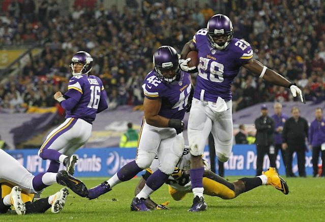 Minnesota Vikings quarterback Matt Cassel (16), left, watches as Minnesota Vikings running back Adrian Peterson (28) makes a break during the NFL football game against Pittsburgh Steelers at Wembley Stadium, London, Sunday, Sept. 29, 2013. (AP Photo/Sang Tan)
