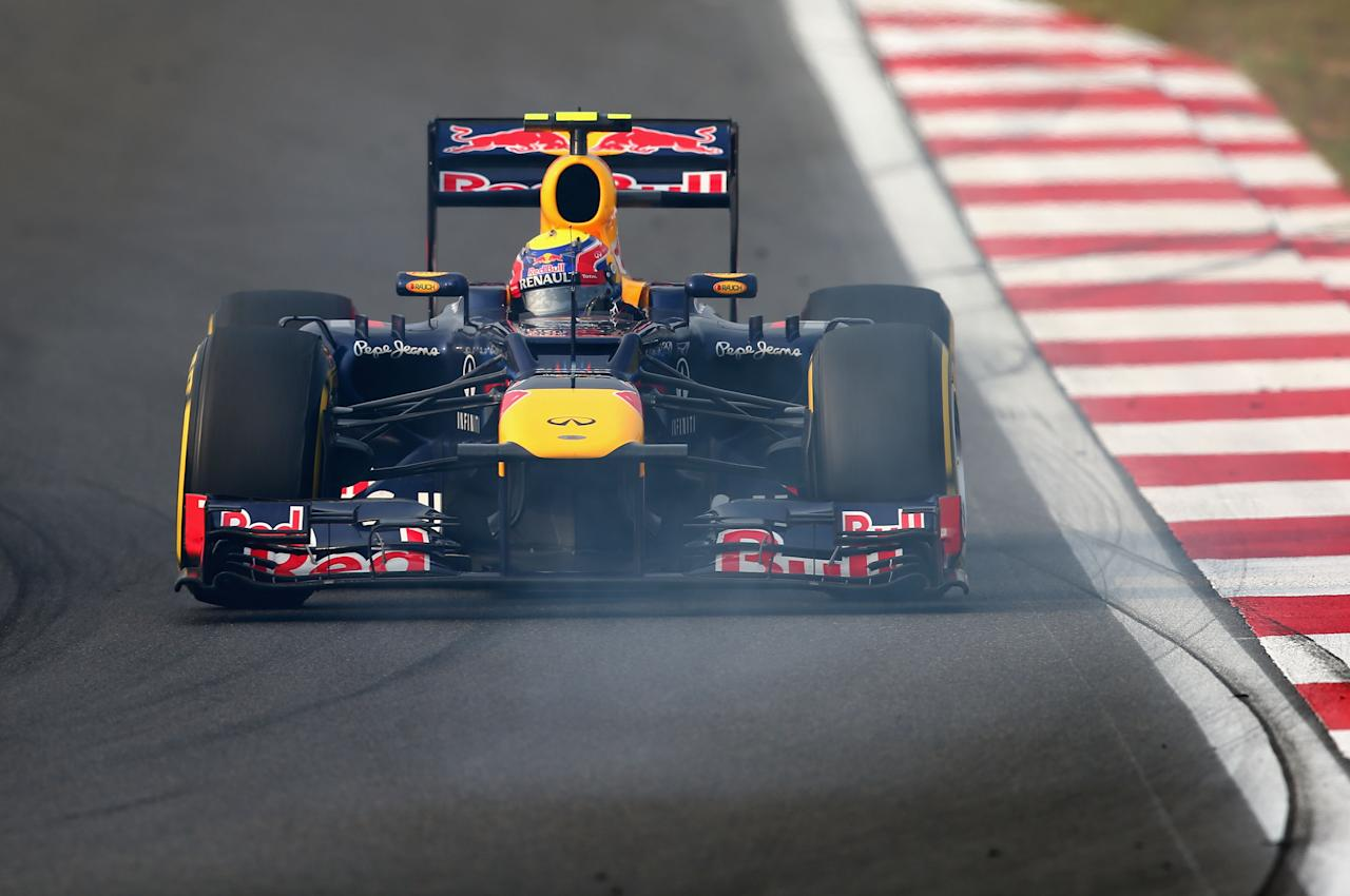 YEONGAM-GUN, SOUTH KOREA - OCTOBER 14:  Mark Webber of Australia and Red Bull Racing drives on his way to finishing second during the Korean Formula One Grand Prix at the Korea International Circuit on October 14, 2012 in Yeongam-gun, South Korea.  (Photo by Clive Mason/Getty Images)