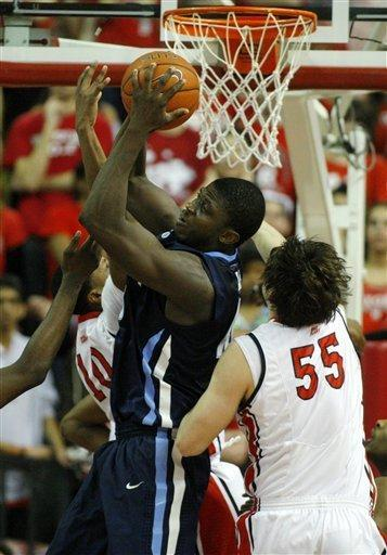 Villanova's Mouphtaou Yarou, center, pulls down a rebound between Rutgers' Mike Poole (10) and Gilvydas Biruta (55), of Lithuania, during the first half of an NCAA college basketball game in Piscataway, N.J., Thursday, March 1, 2012. (AP Photo/Rich Schultz)