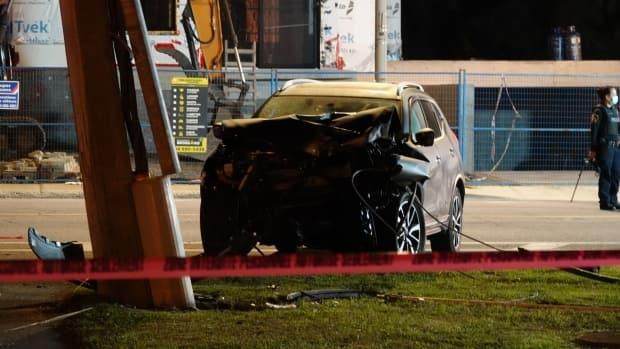Laval police say the vehicle first hit a street sign, then struck the pedestrian, then crashed into a hydro pole.  (Alain Beland/Radio-Canada - image credit)
