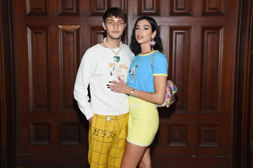 """<p>Dua and Anwar made their first New York Fashion Week appearance together as a couple at the Marc Jacobs Spring 2020 runway show, <a href=""""https://www.popsugar.com/celebrity/dua-lipa-and-anwar-hadid-at-new-york-fashion-week-2019-46611980"""" class=""""link rapid-noclick-resp"""" rel=""""nofollow noopener"""" target=""""_blank"""" data-ylk=""""slk:confirming their relationship"""">confirming their relationship</a>. They showed up in bright color-coordinated outfits paired with heart-shaped accessories. Earlier that month, their relationship had reached another serious milestone when <a href=""""http://people.com/style/the-bachelorette-tyler-cameron-console-gigi-hadid-grandmother-funeral/"""" class=""""link rapid-noclick-resp"""" rel=""""nofollow noopener"""" target=""""_blank"""" data-ylk=""""slk:Dua accompanied Anwar to his grandmother's funeral"""">Dua accompanied Anwar to his grandmother's funeral</a> in the Netherlands.</p> <p><br></p> <p><br></p> <p><br></p>"""