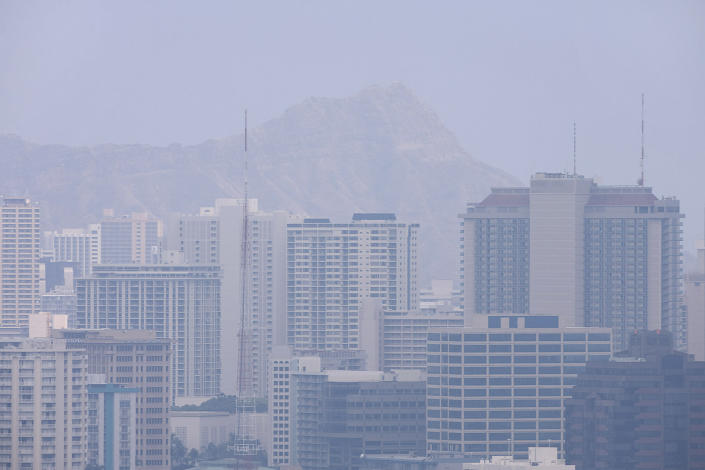 FILE - In this April 26, 2008 file photo, Diamond Head crater and Waikiki high rises are barely visible due to high levels of volcanic fog shrouding Oahu in Honolulu. Part of what makes living in Hawaii so pleasant is the gentle breeze. Nowadays, experts say, these breezes, called trade winds, are declining, a drop that's slowly changing life across the islands. (AP Photo/Marco Garcia, file)