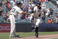 San Francisco Giants' Brandon Belt, right, is congratulated by third base coach Ron Wotus after hitting a home run against the Philadelphia Phillies during the third inning of a baseball game in San Francisco, Saturday, June 19, 2021. (AP Photo/Jeff Chiu)