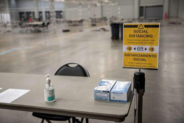 PHOTO: A social distancing sign stands on display at a temporary hospital in the Austin Convention Center in Austin, July 27, 2020. (Sergio Flores/Bloomberg via Getty Images)