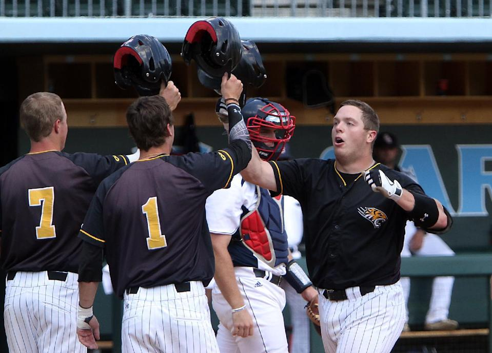 Towson's Andrew Parker, right, celebrates his three-run home run with teammates Hunter Bennett (7) and Dominic Fratantuono (1) during the sixth inning of an NCAA regional tournament college baseball game against Florida Atlantic in Chapel Hill, N.C., Friday, May 31, 2013. (AP Photo/Ted Richardson)