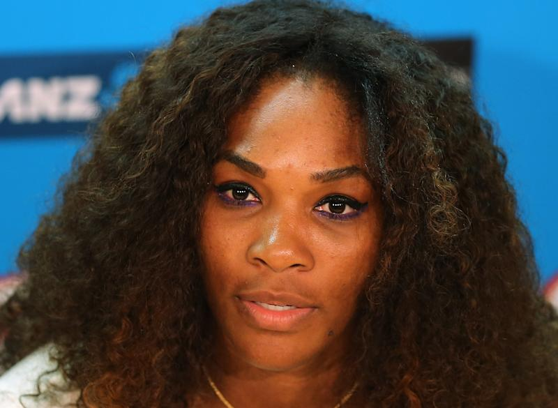 "FILE - In this Jan. 12, 2013 file photo, Serena Williams answers a question during a press conference ahead of  the Australian Open tennis championship in Melbourne, Australia. Williams says she's reaching out to the family of the victim in the Steubenville rape case after the tennis star was quoted in a Rolling Stone article saying ""she shouldn't have put herself in that position."" (AP Photo/Greg Baker, File)"