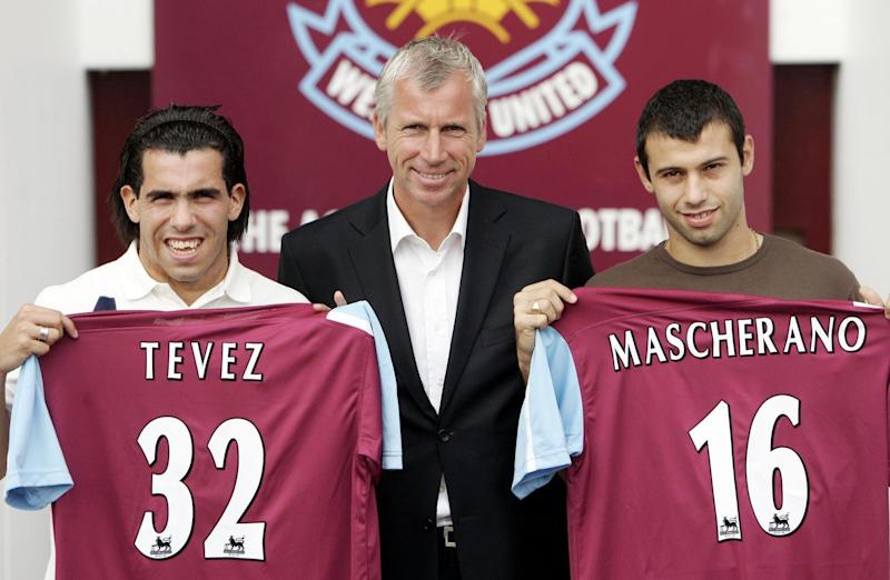 West Ham new signings Carlos Tevez (left) and Javier Mascherano (right) with manager Alan Pardew following a press conference at Upton Park, East London. (Photo by Sean Dempsey - PA Images/PA Images via Getty Images)