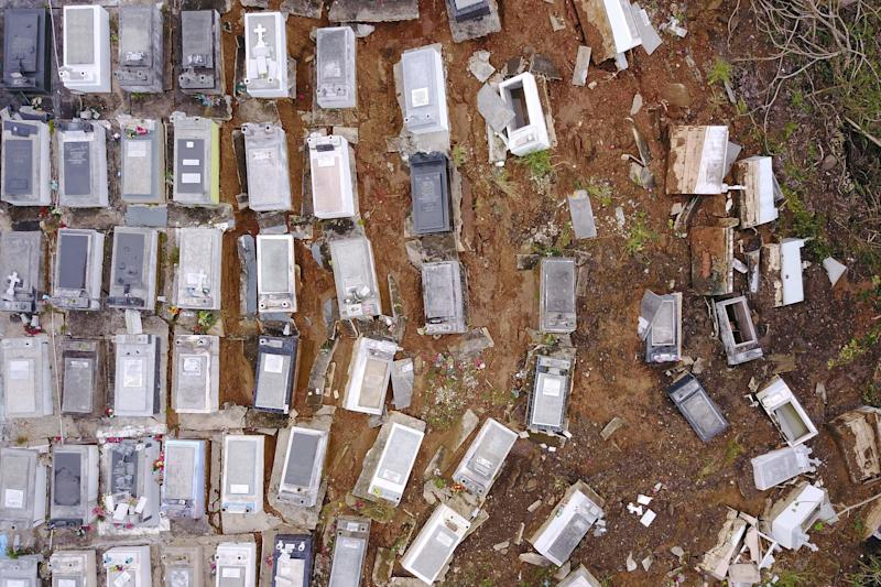 Coffins were washed downhill from the Lares Municipal Cemetery by a landslide in thewake of Hurricane Maria in Puerto Rico.