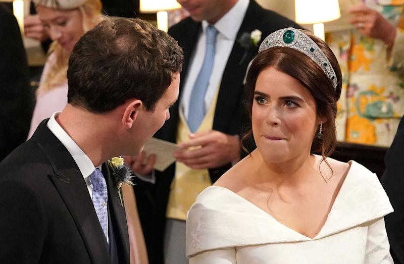 Eugenie makes a face at her groom.