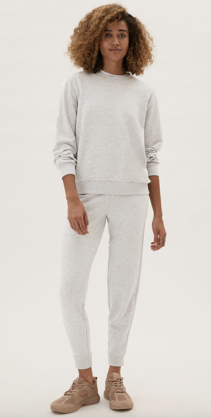 Select from a crew neck sweatshirt, hooded jumper, or wear without the extra layering, the style options are endless when it comes to M&S' lounge set.  (Marks and Spencer)