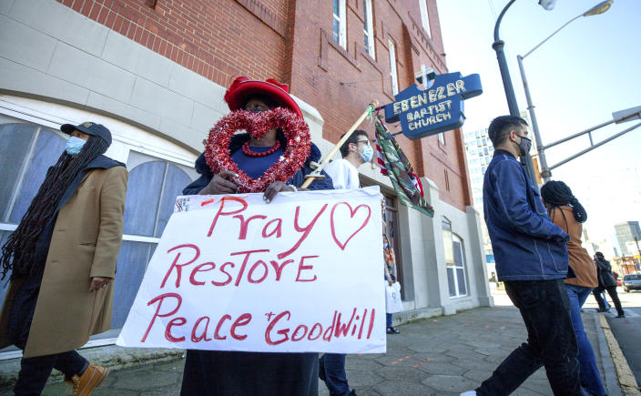 G.A. Breedlove stands outside of the historic Ebenezer First Baptist Church where Martin Luther King Jr. preached on Monday, Jan. 18, 2021, in honor of Martin Luther King Jr. Day, in Atlanta. (AP Photo/Branden Camp)