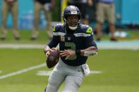 Seattle Seahawks quarterback Russell Wilson (3) looks to pass the ball during the first half of an NFL football game against the Miami Dolphins, Sunday, Oct. 4, 2020 in Miami Gardens, Fla. (AP Photo/Wilfredo Lee)