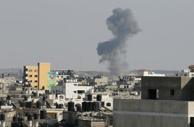 "Smoke is seen after what witnesses said was an Israeli air strike in Gaza City August 19, 2014. Israel launched attacks in the Gaza Strip on Tuesday and recalled its negotiators from truce talks in Cairo after saying three Palestinian rockets had hit southern Israel, hours before a ceasefire was due to expire. A Reuters correspondent saw an Israeli plane fire a missile east of Gaza City. The Israeli military said it was attacking ""terror targets"" across the territory. REUTERS/Suhaib Salem (GAZA - Tags: CIVIL UNREST POLITICS TPX IMAGES OF THE DAY CONFLICT MILITARY)"