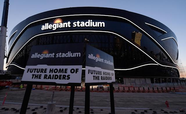 In April, crews test out architectural light ribbons and exterior sign lighting as construction continues at Allegiant Stadium in Las Vegas. (Photo by Ethan Miller/Getty Images)