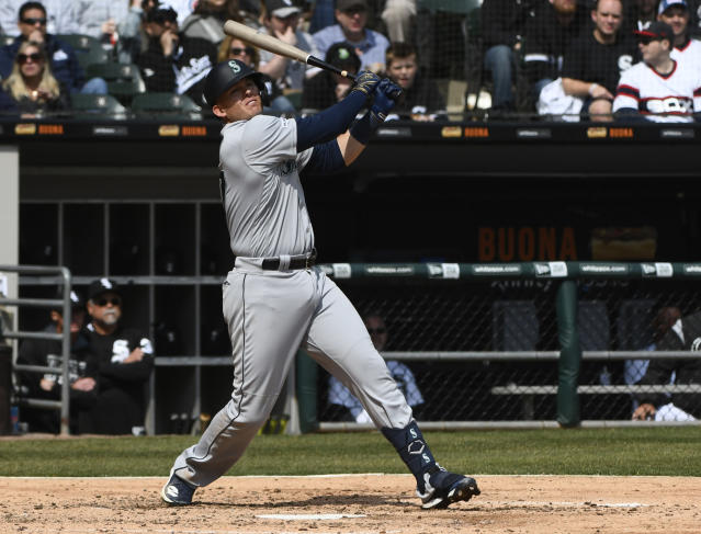 Seattle Mariners' Ryon Healy (27) hits an RBI double against the Chicago White Sox during the fourth inning of a baseball game in Chicago, Saturday, April 6, 2019. (AP Photo/Matt Marton)