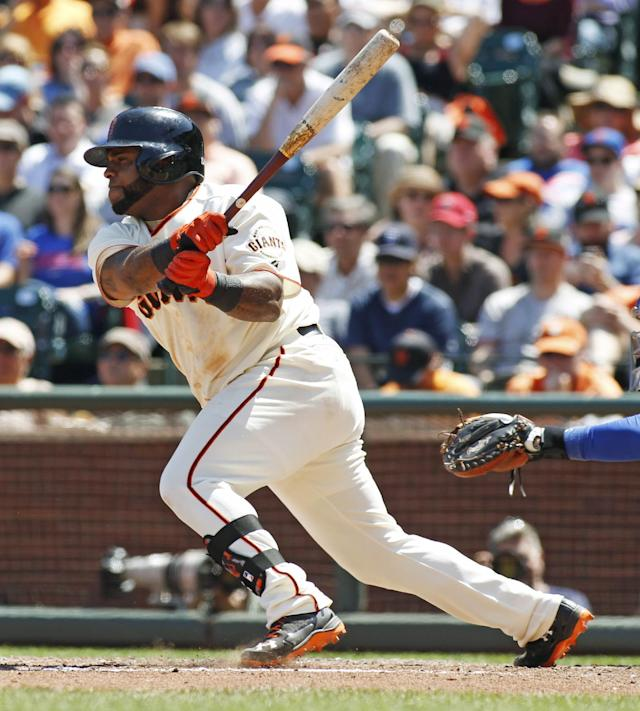San Francisco Giants' Pablo Sandoval watches his RBI single against the Chicago Cubs during the sixth inning of a baseball game, Wednesday, May 28, 2014, in San Francisco. (AP Photo/George Nikitin)
