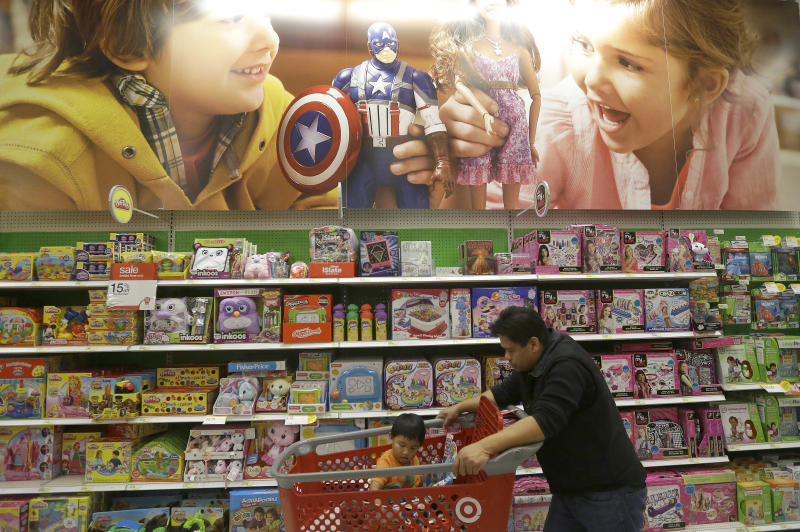 A man pushes a child in shopping cart in the toy department at a Target store in Colma, Calif., on Thanksgiving Day, Thursday, Nov. 28, 2013. Instead of waiting for Black Friday, which is typically the year's biggest shopping day, more than a dozen major retailers opened on Thanksgiving day this year. (AP Photo/Jeff Chiu)