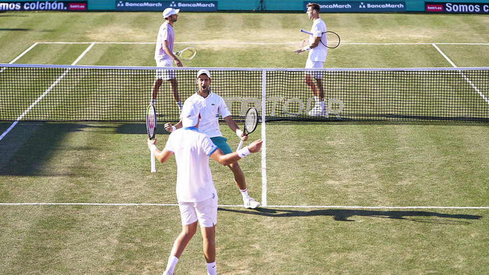 Novak Djokovic and Carlos Gomez Herrera, pictured here playing doubles in Mallorca.