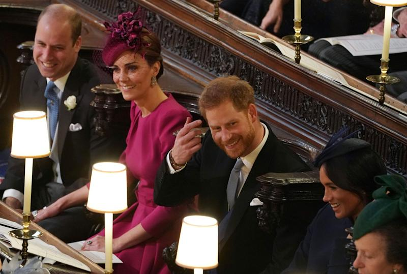 Harry shares a joke with Meghan at Princess Eugenie's wedding (Getty)