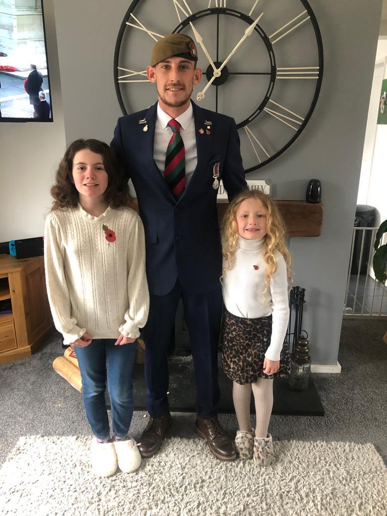 Former infantry soldier Ben Bainbridge and daughters Ellie, 11, and Ariel, seven (Help for Heroes/PA)