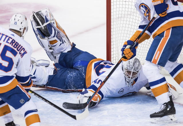 New York Islanders goalie Robin Lehner sprawls across the goal after the puck deflected off the post during the second period of an NHL hockey game against the Vancouver Canucks on Saturday, Feb. 23, 2019, in Vancouver, British Columbia. (Darryl Dyck/The Canadian Press via AP)