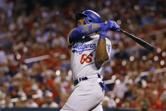 Yasiel Puig helped the Los Angeles Dodgers pull even with the St. Louis Cardinals for the NL's second Wild Card with two homers Friday night. (AP)