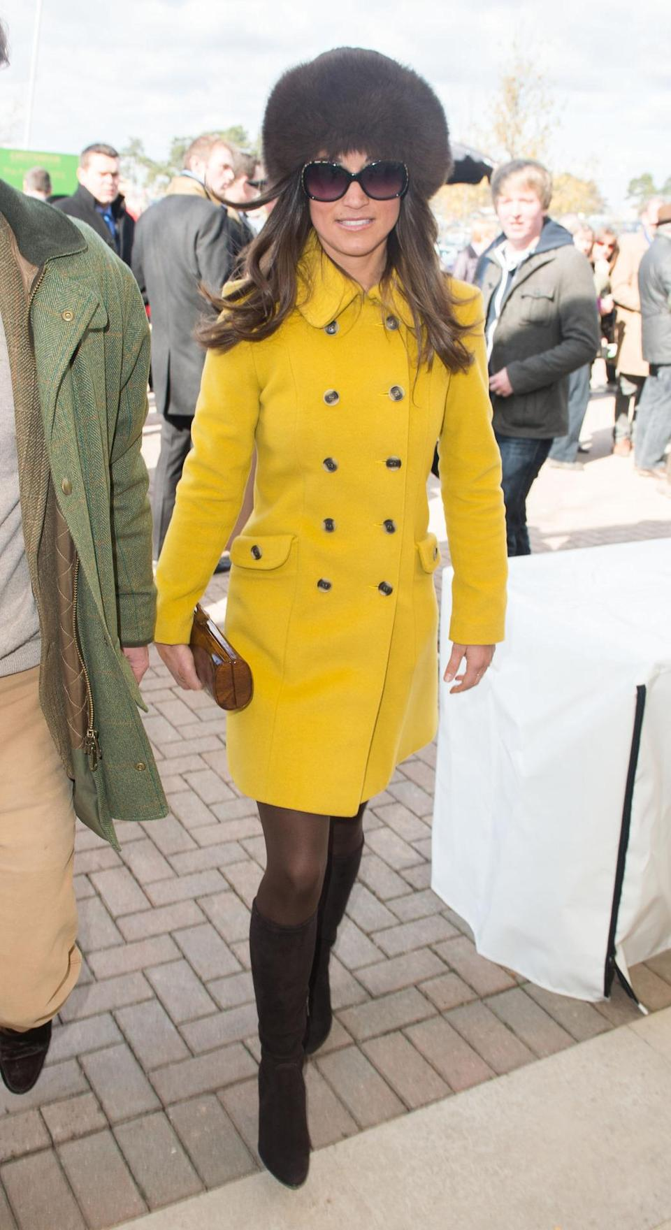 <p>Wearing a bright and bold coat by Katherine Hooker paired with a statement fur hat to the races in spring 2013, Pippa showed she's not afraid to stand out. <i>[Photo: PA Images]</i> </p>