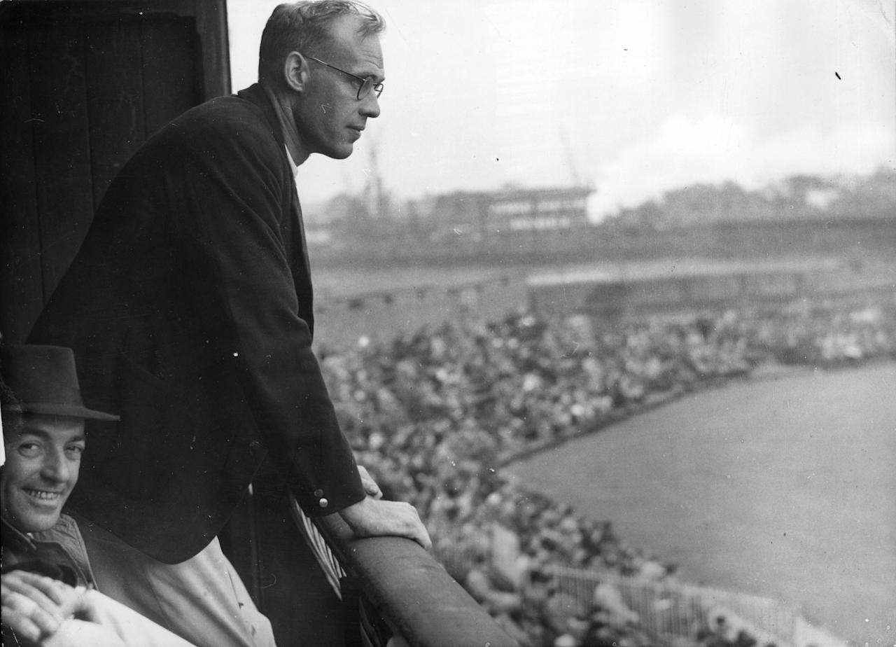 4th July 1945:  English test cricketer Bill Bowes (1908 - 1987), who was recently repatriated from a POW camp in Germany,  watching the Yorkshire versus Lancashire match at Old Trafford, Manchester.  (Photo by Keystone/Getty Images)