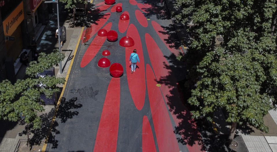 Aerial view of a pedestrian on a promenade in downtown Santiago on March 20, 2021, during a lockdown in 24 communes of the city amid the fight against the spread of the COVID-19. - Chile surpassed on Saturday for the first time since the beginning of the pandemic the 7,000 daily cases of COVID-19, amid an increase of contagions which led authorities to confine 24 municipalities and to put all travellers into quarantine. (Photo by MARTIN BERNETTI / AFP) (Photo by MARTIN BERNETTI/AFP via Getty Images)
