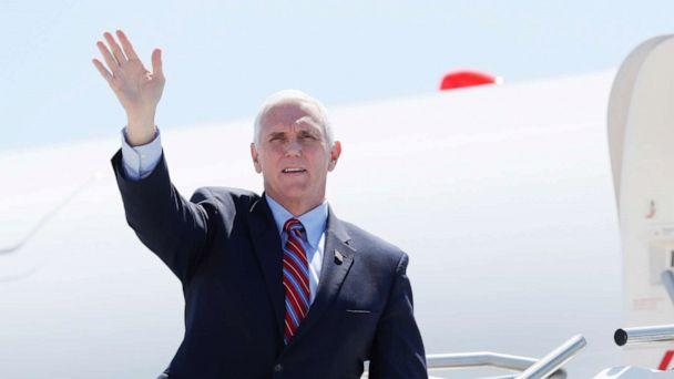PHOTO: Vice President Mike Pence waves as he stops off Air Force Two after arriving at the Des Moines International Airport, May 8, 2020, in Des Moines, Iowa. (Charlie Neibergall/AP)