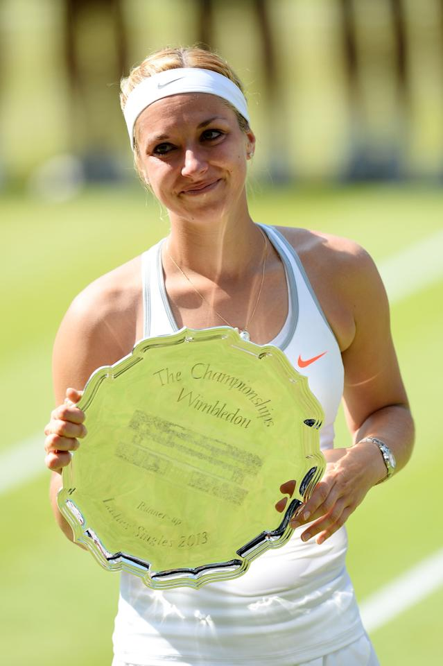 LONDON, ENGLAND - JULY 06: Sabine Lisicki of Germany poses with her runner-up trophy on Centre Court after her Ladies' Singles final match against Marion Bartoli of France on day twelve of the Wimbledon Lawn Tennis Championships at the All England Lawn Tennis and Croquet Club on July 6, 2013 in London, England. (Photo by Mike Hewitt/Getty Images)
