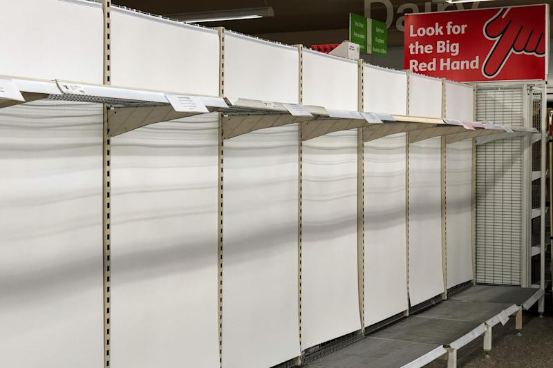 Coles shelves have been left open as people scramble to stock up during coronavirus panic. Source: AAP