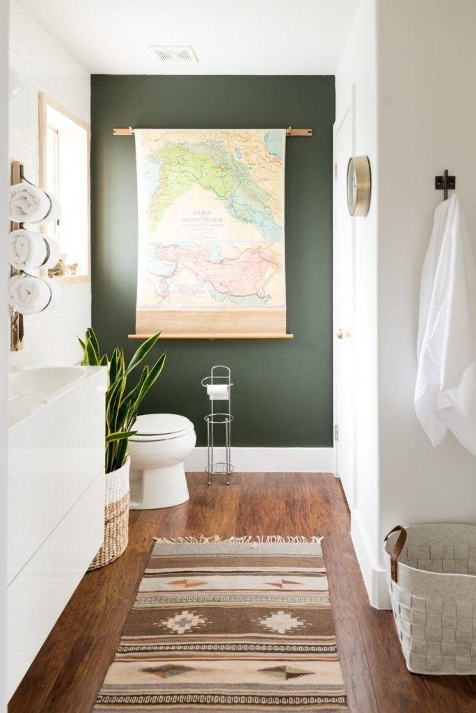 <p>Give a basic bathroom a bohemian-inspired upgrade with an emerald green accent wall. Add an oversized piece of art, like this map, to make even more of an impact. </p>