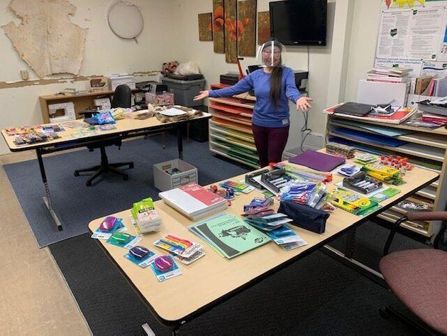 A teacher at Helen Kalvak School in Nunavut with school supplies donated from Facebook group