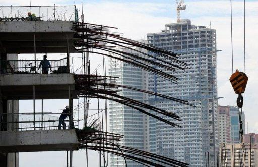 Workers are seen at a construction site in Manila