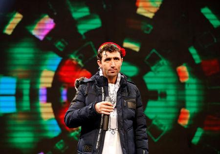 "Afghan singer Abdul Salam Maftoon, 28, performs during rehearsals in the ""Afghan Star"" talent show at Tolo television studio in Kabul, Afghanistan January 16, 2019. REUTERS/Mohammad Ismail"