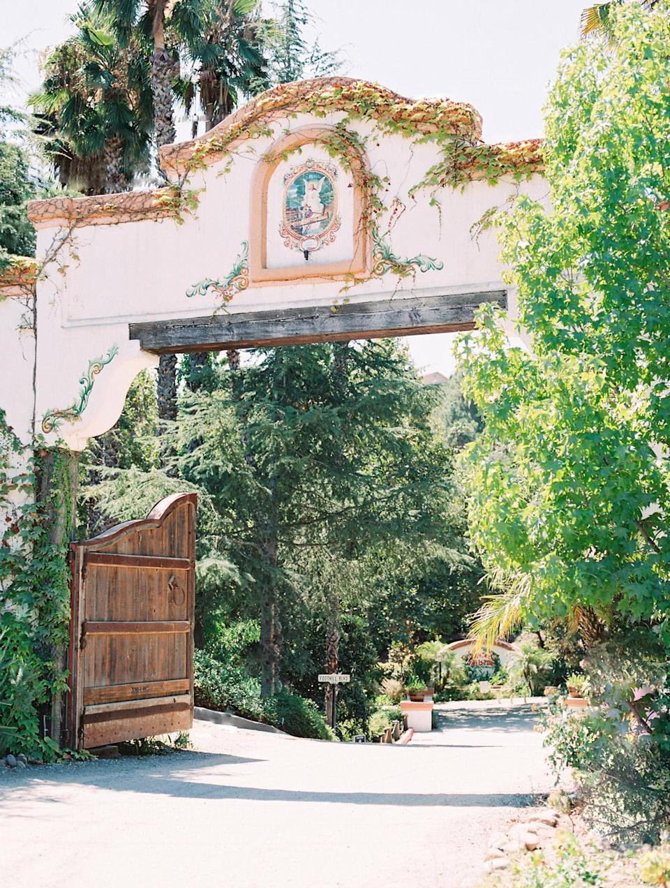 """<p>""""We fell in love with Rancho Las Lomas on a rainy Valentine's Day,"""" shares Ana. """"The Spanish private state has beautiful details, such as hand-printed title murals and 100-year-old Pasadena street lamps hidden in the Silverado hills."""" She and Charles loved the on-site nature, including the many oak and sycamore trees—plus the """"casitas,"""" which allowed family to stay on-site.</p>"""