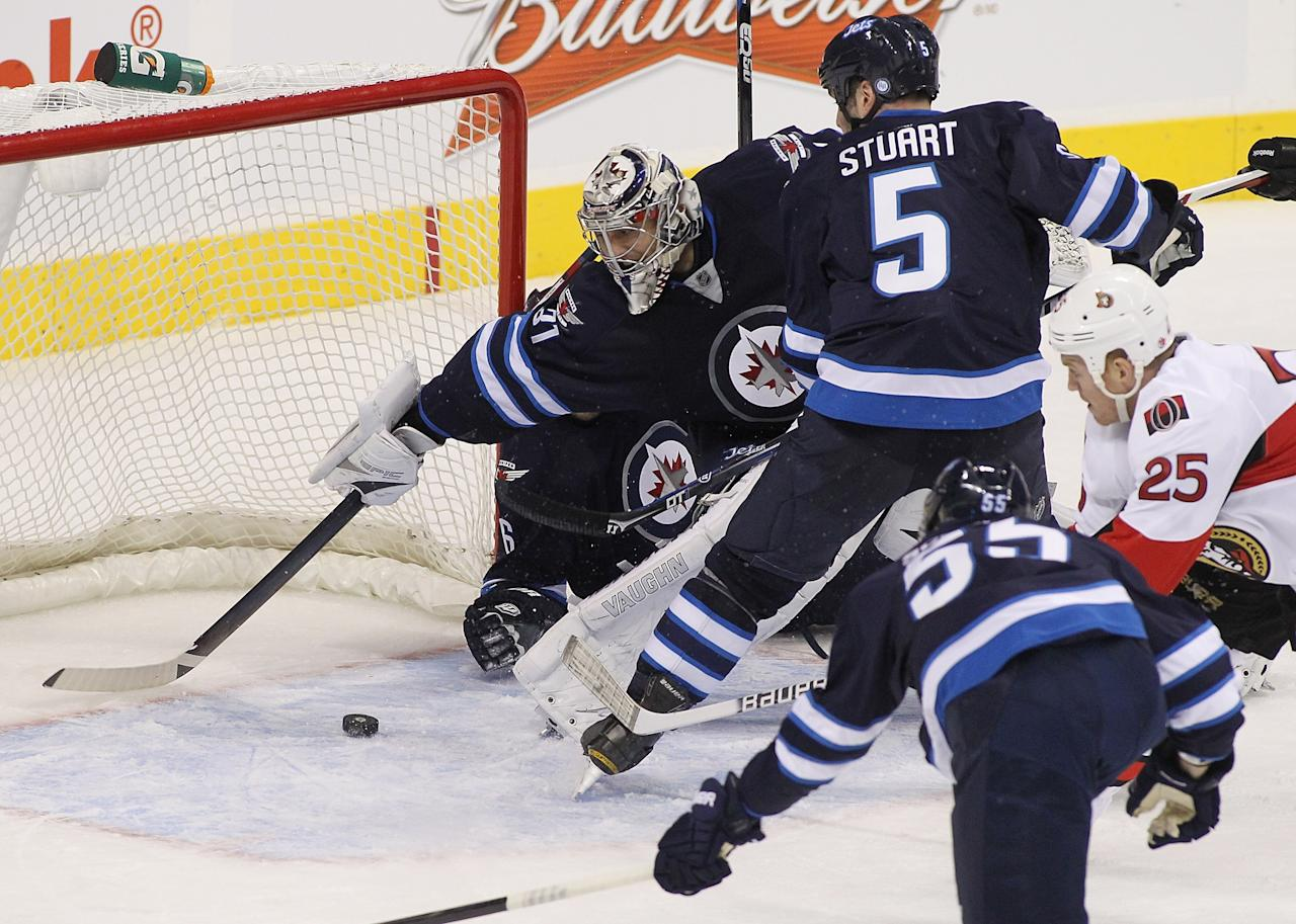 WINNIPEG, MB - JANUARY 19:  Ondrej Pavelec #31 of the Winnipeg Jets reaches but can't stop Chris Neil #25 of the Ottawa Senators from scoring during second period action on January 19, 2013 at the MTS Centre in Winnipeg, Manitoba, Canada. (Photo by Marianne Helm/Getty Images)