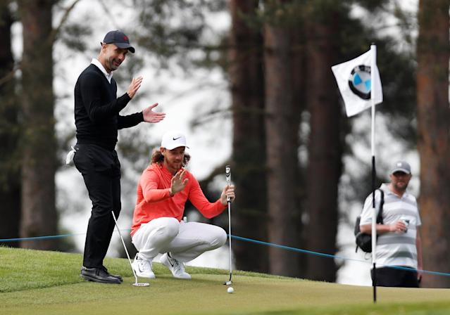 Golf - European Tour - BMW PGA Championship - Wentworth Club, Virginia Water, Britain - May 23, 2018 Manchester City manager Pep Guardiola and England's Tommy Fleetwood during the pro-am Action Images via Reuters/Paul Childs