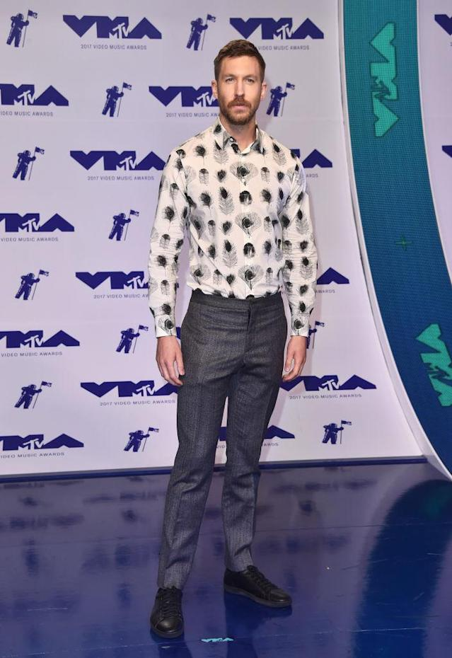 <p>Calvin Harris wore a collared shirt covered in feathers. (Photo: Getty Images) </p>