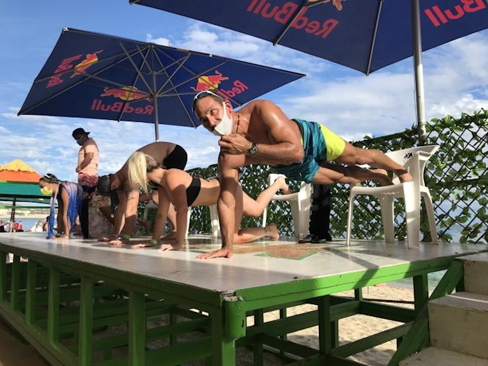 A push-up competition Dec 8 at Mango Deck, a beach bar in Cabo San Lucas, competitors were required to begin with masks, but many quickly fell off.