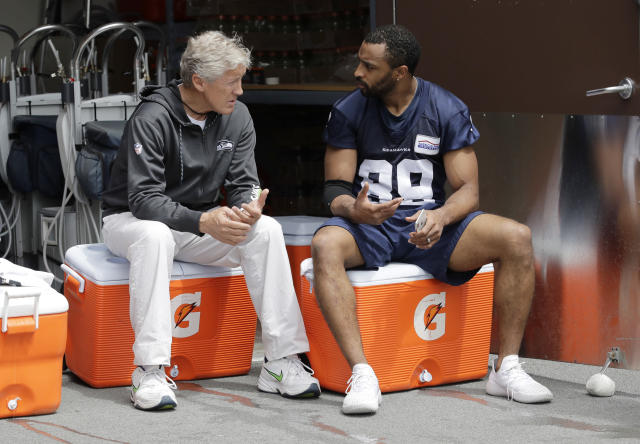 Seattle Seahawks wide receiver Doug Baldwin, right, talks with head coach Pete Carroll, left, following NFL football practice, Thursday, May 24, 2018, in Renton, Wash. (AP Photo/Ted S. Warren)