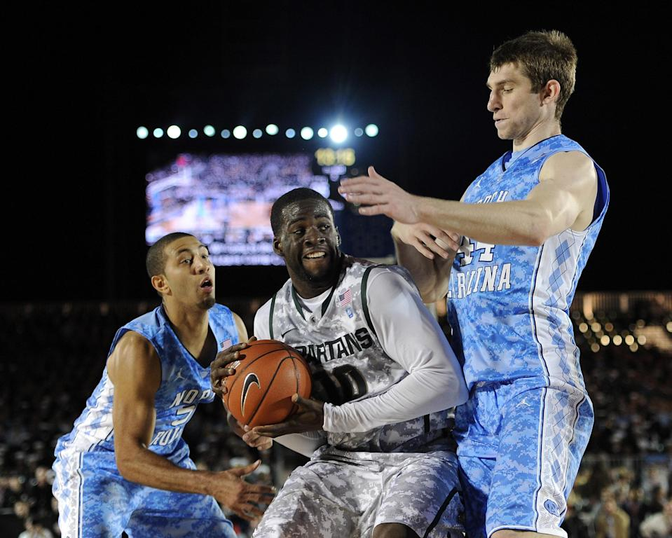 CORONADO, CA - NOVEMBER 11: Draymond Green #10 of the Michigan State Spartans goes in for a shot in front of Tyler Zeller #44 and Kendall Marshall #5 of the North Carolina Tar Heels during the Quicken Loans Carrier Classic on board the USS Carl Vinson on November 11, 2011 in Coronado, California. The Tar Heels won 67-55. (Photo by Harry How/Getty Images)
