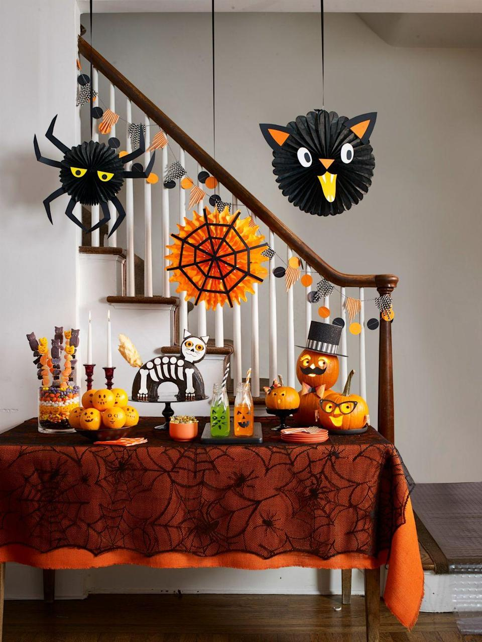 """<p>Suspend a few high-flying critters over the snack table at your Halloween party to really get everyone in the spirit. </p><p><strong>What You'll Need:</strong> <a href=""""https://www.amazon.com/Halloween-Decorations-Colorful-Streamers-Supplies/dp/B07XL4R37L/ref=sr_1_4?dchild=1&keywords=halloween+ceiling+decor&qid=1594917483&sr=8-4&tag=syn-yahoo-20&ascsubtag=%5Bartid%7C10070.g.1279%5Bsrc%7Cyahoo-us"""" rel=""""nofollow noopener"""" target=""""_blank"""" data-ylk=""""slk:Halloween hanging decor"""" class=""""link rapid-noclick-resp"""">Halloween hanging decor</a> ($10, Amazon); </p>"""